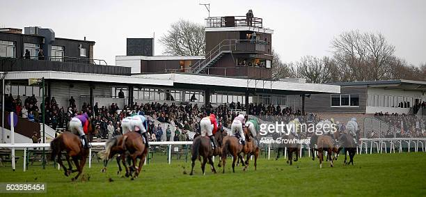 Runners make their way past the grandstands at Huntingdon racecourse on January 06 2016 in Huntingdon England