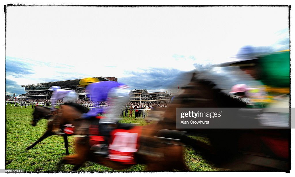 Runners make their way past the grandstands in The Ladbrokes World Hurdle Race during St Patrick's Thursday at Cheltenham racecourse on March 14, 2013 in Cheltenham, England.