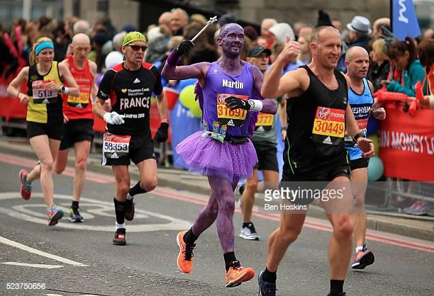 Runners make their way past Tower Bridge during the Virgin Money London Marathon on April 24 2016 in London England