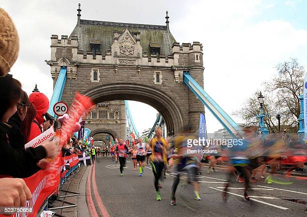Runners make their way past Tower Bridge during the Virgin Money London Marathon on April 24 2016 in London England