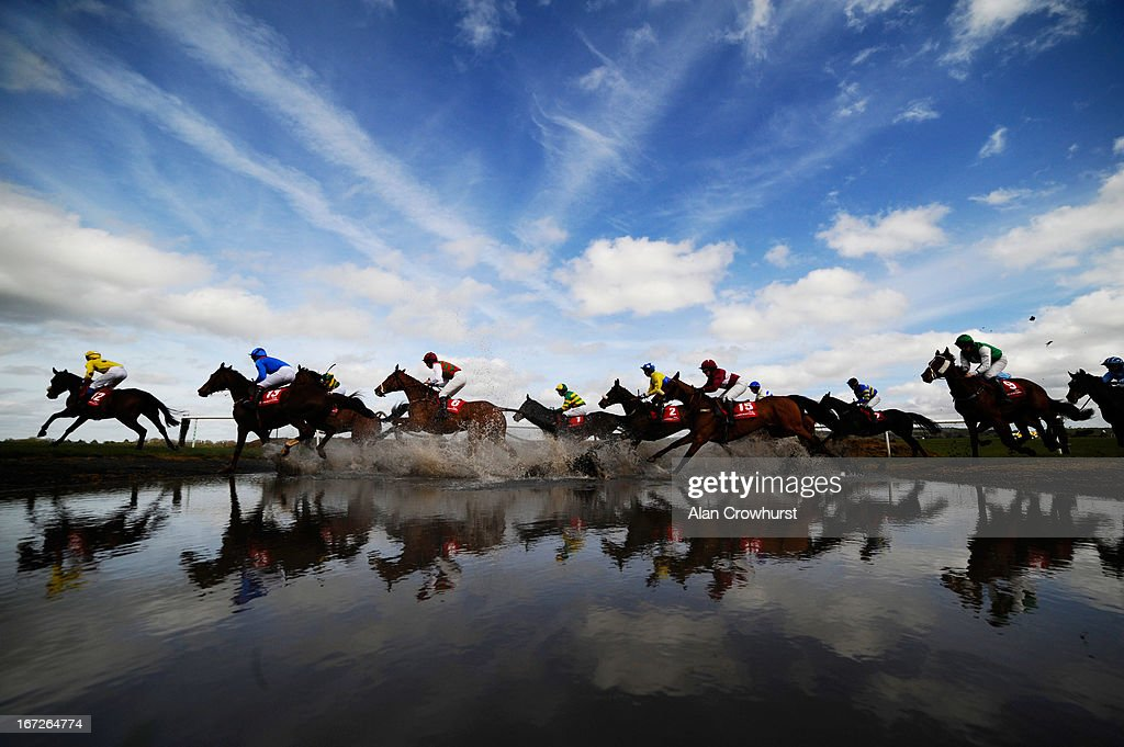 Runners make their way through 'Joe's Water Splash' at Punchestown racecourse on April 23, 2013 in Naas, Ireland.