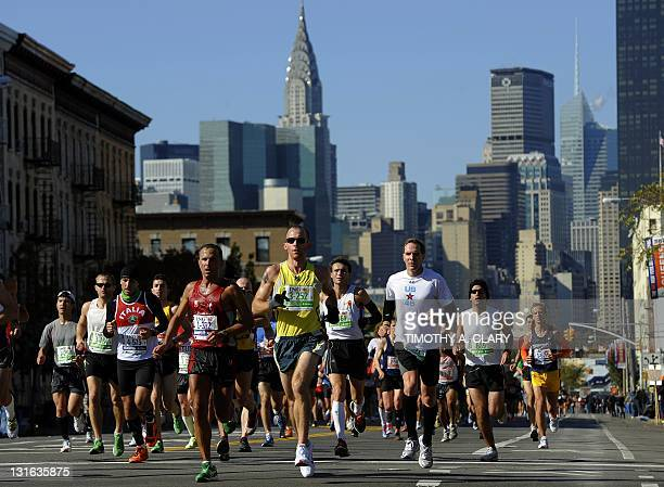 Runners make their way through Queens during the 2011 ING New York City Marathon in New York November 6 2011 The 262 mile marathon courses through...