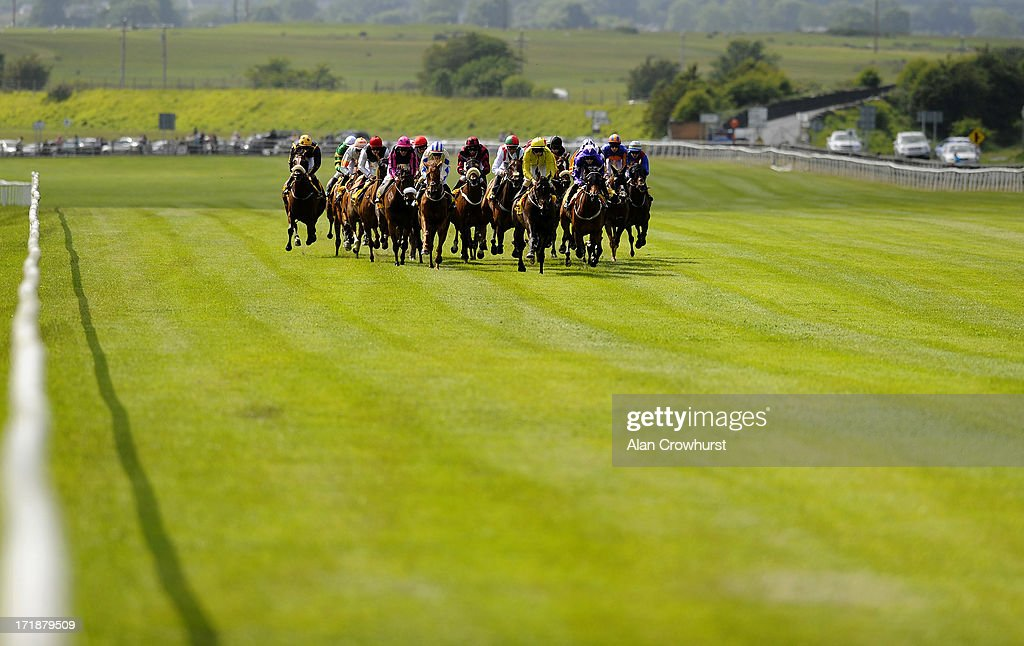 Runners make their way towards the finish in The Dubai Duty Free Jumeirah Creekside Hotel Summer Fillies Handicap at Curragh racecourse on June 29, 2013 in Kildare, Ireland.
