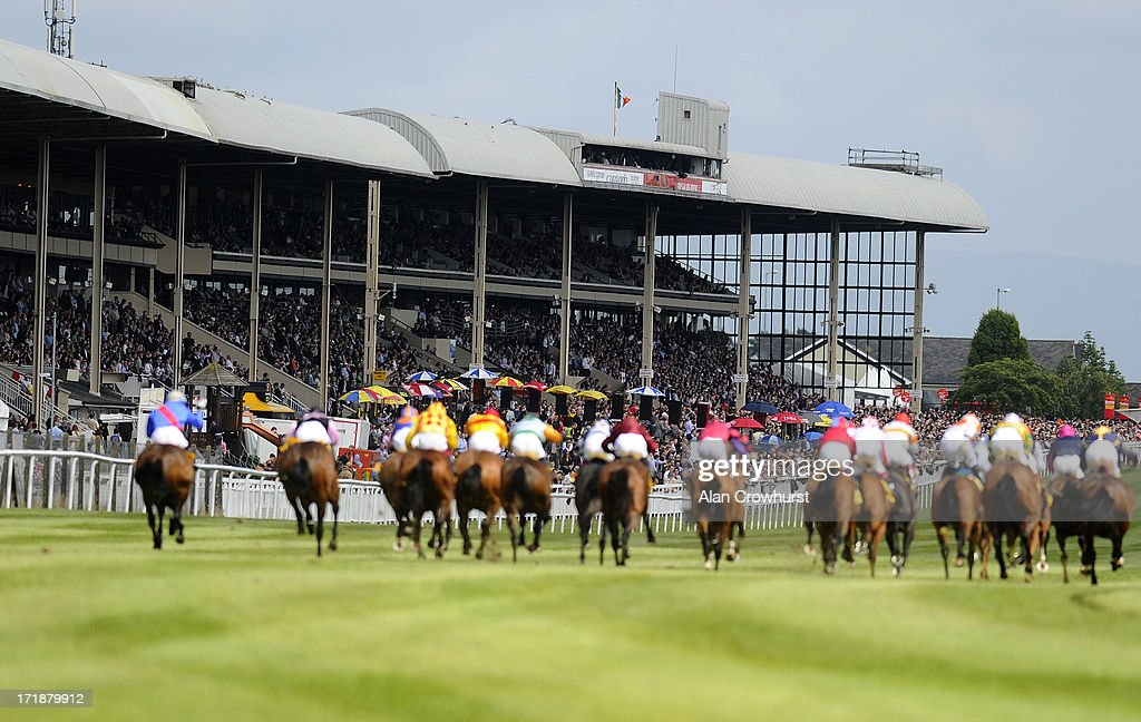 Runners make their way towards the finish in The Dubai Duty Free Jumeirah Creekside Hotel Summer Fillies Handicap as a large crowd look on at Curragh racecourse on June 29, 2013 in Kildare, Ireland.