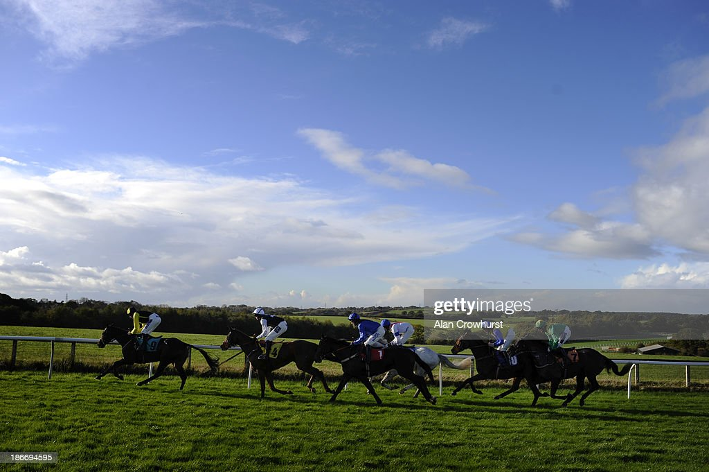 Runners make their way up the home straight with a circuit to run at Carlisle racecourse on November 03, 2013 in Carlisle, England.