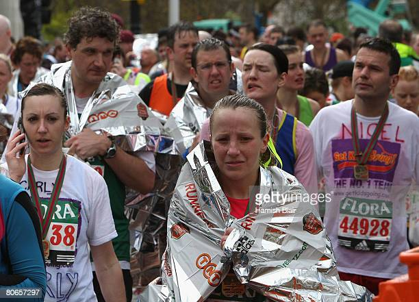 Runners make their way up the mall wrapped in space blankets after finishing during the 2008 Flora London Marathon on April 13 2008 in London England