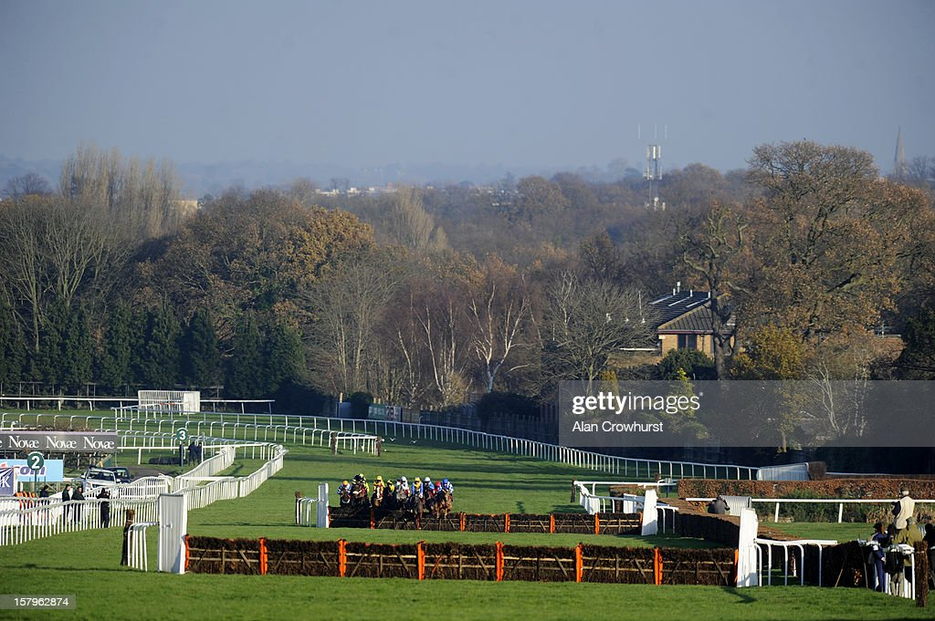 Runners make their way up the straight in The Pertemps Network Handicap Hurdle at Sandown racecourse on December 08, 2012 in Esher, England.