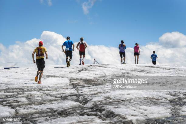 Runners makes their way on the Tsanfleuron Glacier during the last kilometres of the Glacier 3000 run and marathon run above Les Diablerets on August...