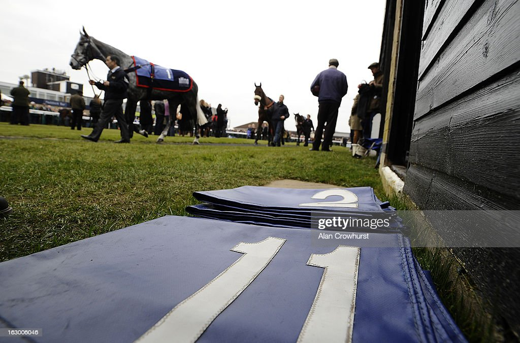 Runners number cloths lay on the ground in the parade ring at Huntingdon racecourse on March 03, 2013 in Huntingdon, England.
