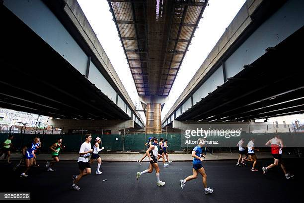 Runners of the 40th ING New York City Marathon pass under the Williamsburg Bridge in the Williamsburg section of the borough of Brooklyn on November...