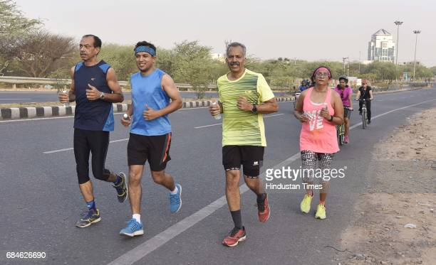 Runners on Gurgaon Faridabad Road on May 14 2017 in Gurgaon India GurgaonFaridabad Expressway is one of most popular Biking Trails amongst cyclists...