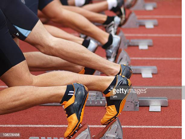 Runners on starting blocks