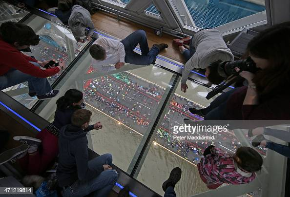 Runners on The Virgin Money London Marathon cross the River Thames as seen from The Tower Bridge Exhibitions Glass Flooring on April 26 2015 in...