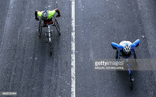 Runners on wheelchairs are seen at the start of the 90th Sao Silvestre international 15 km race in Sao Paulo Brazil on 31 December 2014 Thirty...