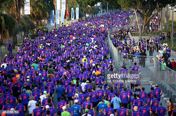 Runners participate in the 2015 Tel Aviv Marathon on February 27 2015 in the Mediterranean coastal city of Tel Aviv AFP PHOTO / GIL COHENMAGEN