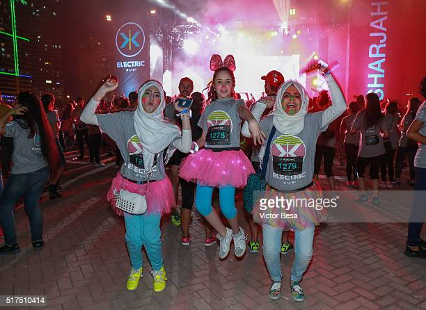 Runners participate in the Electric Run at Al Majaz Amphitheatre Sharjah Waterfront on 25th March 2016 in Sharjah United Arab Emirates