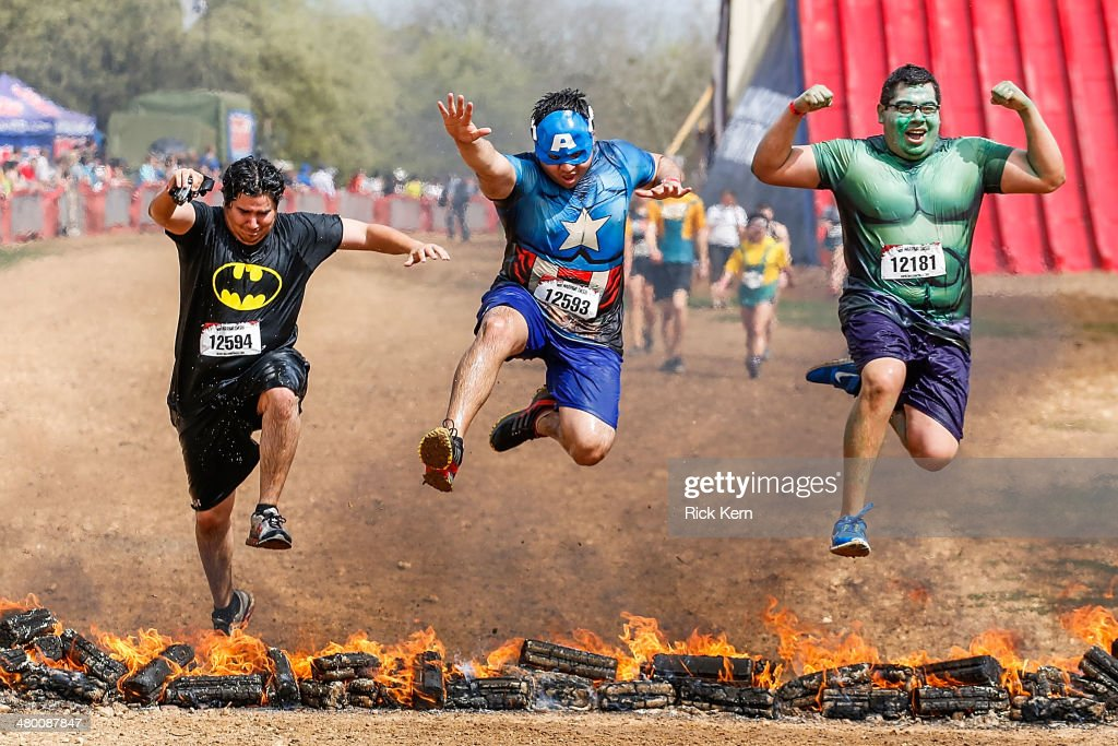 Runners participate in Warrior Dash, World's Largest Obstacle Race Series on March 22, 2014 in Smithville, Texas.
