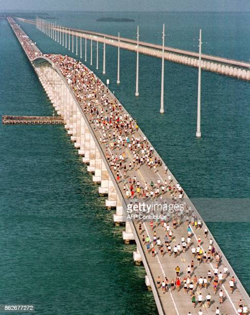 Runners participating in the 20th Annual Seven Mile Bridge Run race across the longest of 42 bridges over water that help comprise the Florida Keys'...
