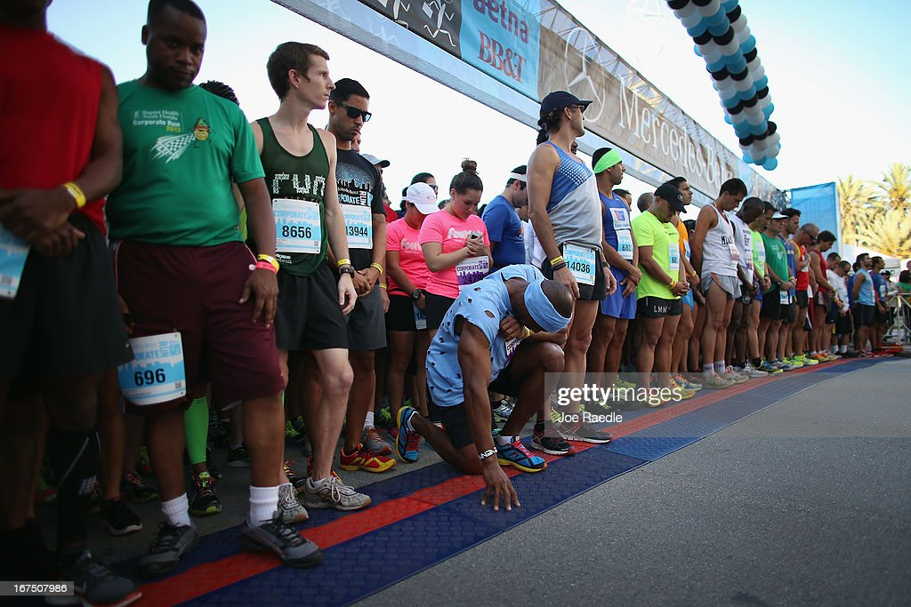 Runners participating in the Mercedes-Benz Corporate Run observe a moment of silence before the start of the race for the victims of the bombing at the Boston Marathon on April 25, 2013 in Miami, Florida. More than 20,000 people participated in the run where security was stepped up.