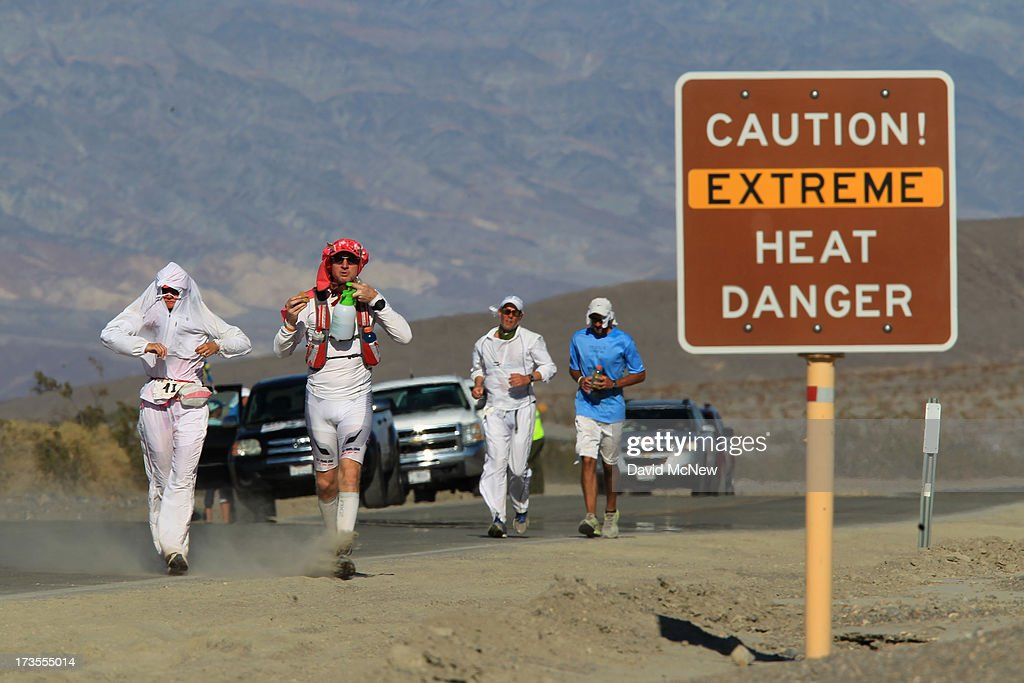 Runners pass a heat danger warning sign during the AdventurCORPS Badwater 135 ultra-marathon race on July 15, 2013 in Death Valley National Park, California. Billed as the toughest footrace in the world, the 36th annual Badwater 135 starts at Badwater Basin in Death Valley, 280 feet below sea level, where athletes begin a 135-mile non-stop run over three mountain ranges in extreme mid-summer desert heat to finish at 8,350-foot near Mount Whitney for a total cumulative vertical ascent of 13,000 feet. July 10 marked the 100-year anniversary of the all-time hottest world record temperature of 134 degrees, set in Death Valley where the average high in July is 116. A total of 96 competitors from 22 nations are attempting the run which equals about five back-to-back marathons. Previous winners have completed all 135 miles in slightly less than 24 hours.