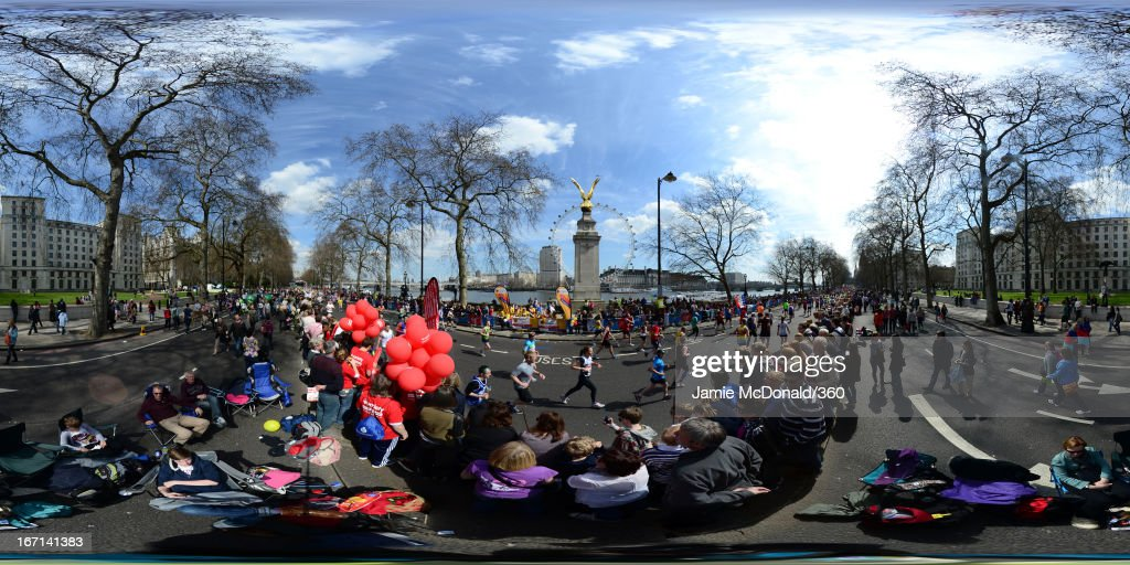 Runners pass along the Embankment past the Royal Air Force Monument with the London Eye and the South Bank visible on the far bank of the River Thames during the Virgin London Marathon 2013 on April 21, 2013 in London, England