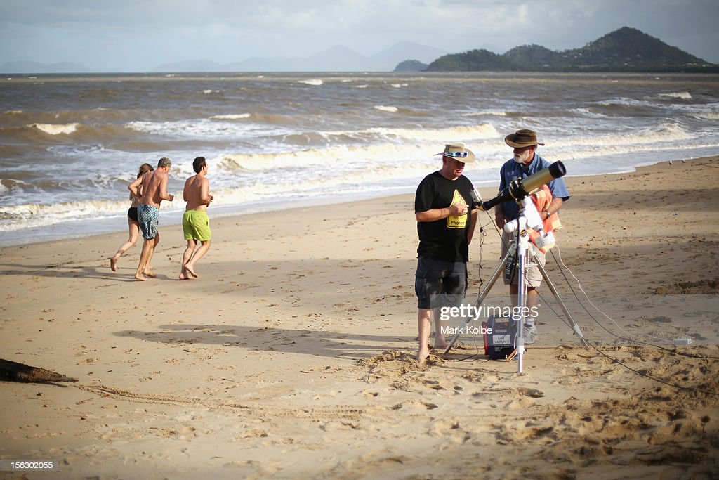 Runners pass as telescopic cameras and computer equipment are set up on Palm Cove beach in preparation to run a live stream via NASA of the total solar eclipse on November 13, 2012 in Cairns, Australia. Thousands of eclipse-watchers have gathered in part of North Queensland to enjoy the solar eclipse, the first in Australia in a decade.