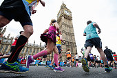Runners pass Big Ben during the Virgin Money London Marathon on April 24 2016 in London England
