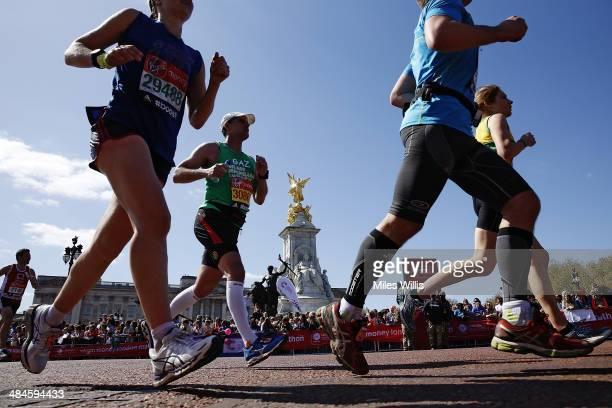 Runners pass Buckingham Palace during the Virgin London Marathon on April 13 2014 in London England