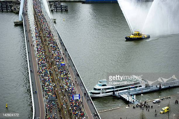 Runners pass the Erasmusbridge in the center of Rotterdam The Netherlands during the Rotterdam Marathon on April 15 2012 AFP PHOTO/ ANP/ ROBIN UTRECHT