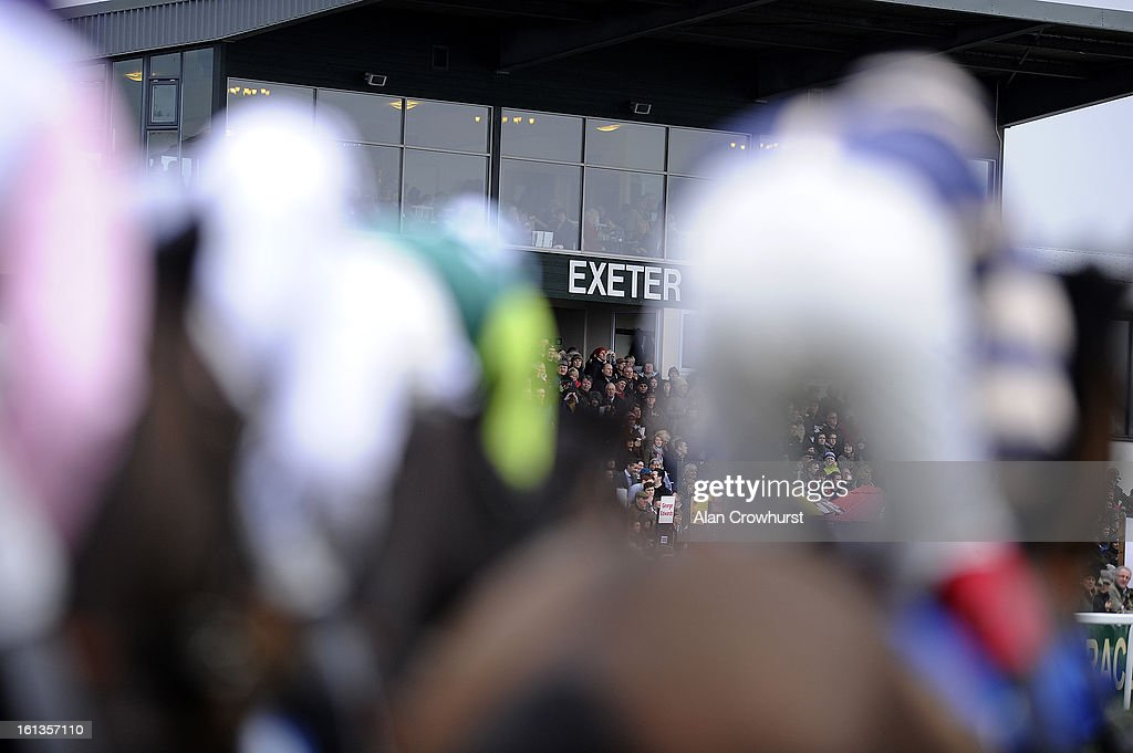 Runners pass the grandstand at Exeter racecourse on February 10, 2013 in Exeter, England.