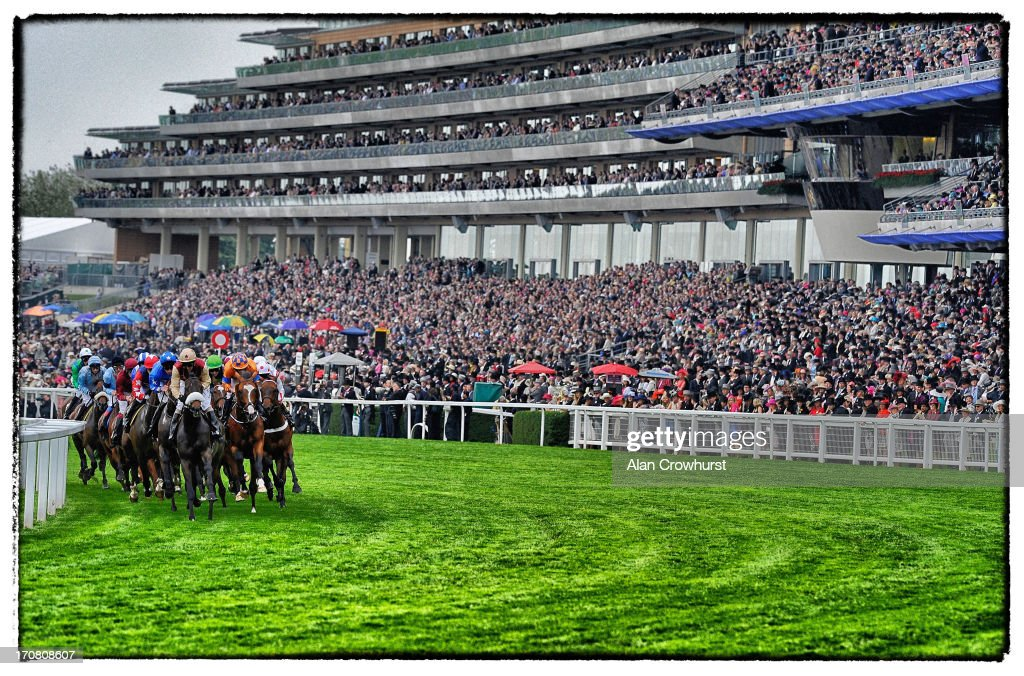 Runners pass the grandstand in the Ascot Stakes during day one of Royal Ascot at Ascot Racecourse on June 18, 2013 in Ascot, England.