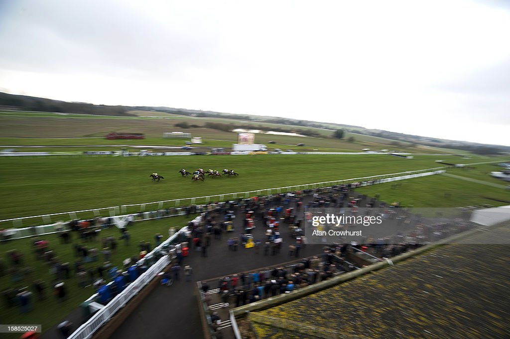 Runners pass the grandstands in The BetVictor Exclusive Antepost Offer Cheltenham 2013 Maiden Hurdle Race during the last meeting to be held after 114 years of racing at Folkestone racecourse on December 18, 2012 in Folkestone, England.