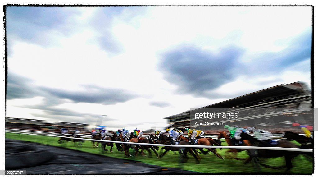 Runners pass the grandstands in The JLT Speciality Handicap Steeple Chase during Champion Day at Cheltenham racecourse on March 12, 2013 in Cheltenham, England.