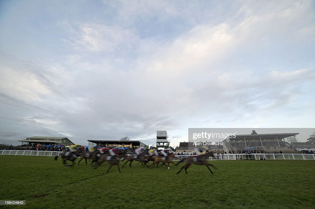 Runners pass the grandstands in The Thermolast Handicap Hurdle Race, the last race of the day during the last meeting to be held at Hereford racecourse after 241 years of racing on December 16, 2012 in Hereford, England.