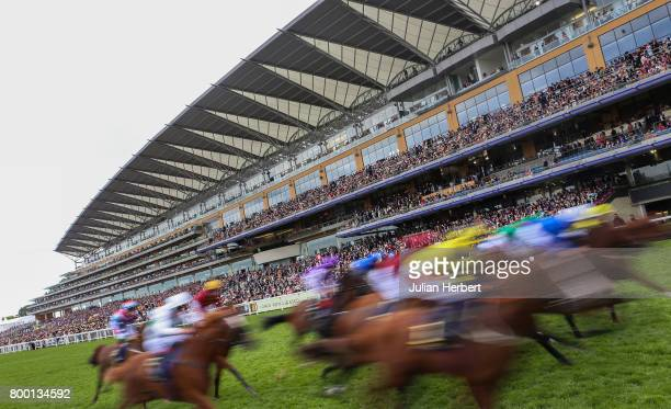 Runners pass the stands for the 1st time during The Queen's Vase run on Day Four of Royal Ascot at Ascot Racecourse on June 23 2017 in Ascot England