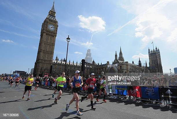 Runners pass Westminster during the Virgin London Marathon 2013 on April 21 2013 in London England