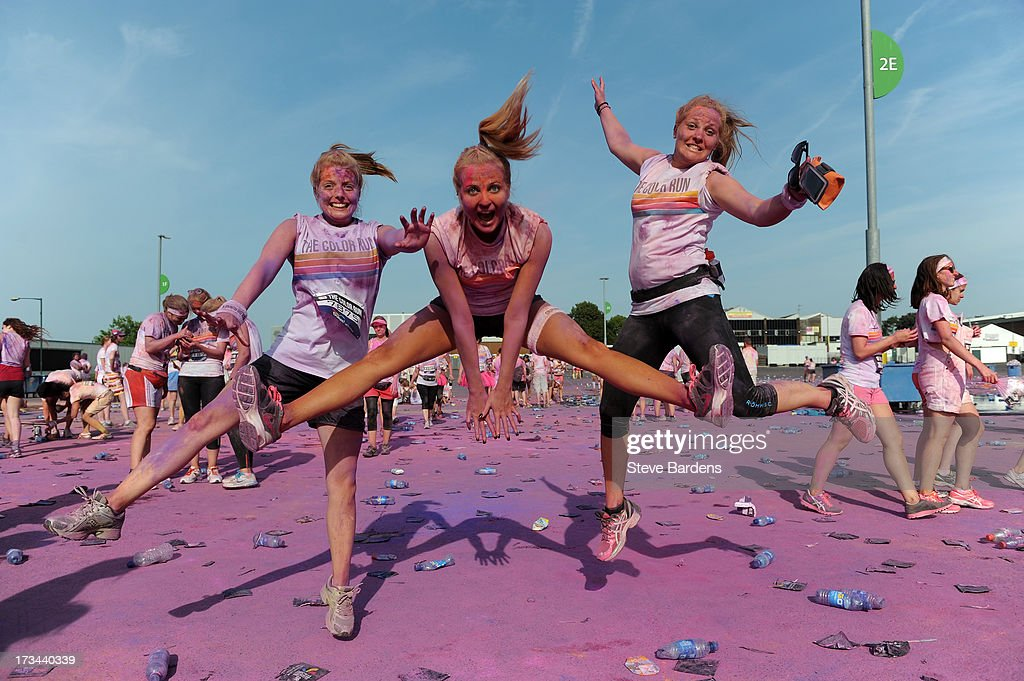Runners pose after completing The Color Run presented by Dulux, known as the happiest 5km on the planet, on July 14 in Wembley, England. Runners of all shapes, sizes and speeds start wearing white clothing that is a blank canvas for the kaleidoscope of colours they encounter around The Color Run course. At each kilometre a different colour of powder is thrown in the air with the runners becoming a constantly evolving artwork. At the end of the course runners are greeted by the Colour Festival where the air is filled with music and stunning coloured powder bursts creating a vibrant party atmosphere. www.thecolorrun.co.uk [Media contact: alex.coulson@img.com] on July 14, 2013 in Wembley, England.