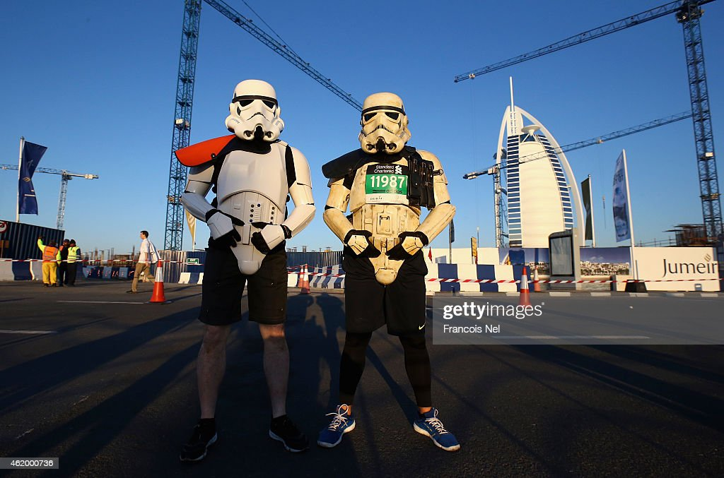 Runners pose in front of Bur Al Arab during the Standard Chartered Dubai Marathon on January 23, 2015 in Dubai, United Arab Emirates.