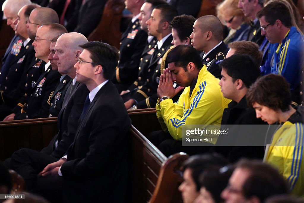 Runners pray at an interfaith prayer service for victims of the Boston Marathon attack titled 'Healing Our City,' and attended by President Barack Obama and first lady Michelle Obama at the Cathedral of the Holy Cross on April 18, 2013 in Boston, Massachusetts. Authorities investigating the attack on the Boston Marathon have shifted their focus to locating the person who placed a black bag down and walked away just before the bombs went off. The twin bombings at the 116-year-old Boston race, which occurred near the marathon finish line, resulted in the deaths of three people and more than 170 others injured.