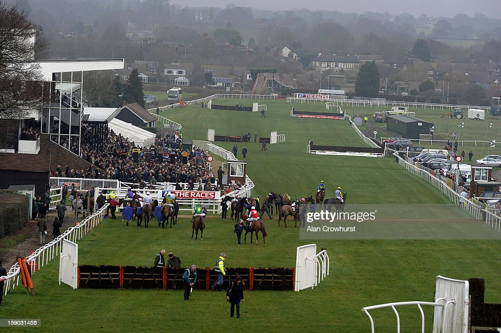 Runners pull up after finishing The At The Races Sky 415 Novices' Hurdle Race at Plumpton racecourse on January 06, 2013 in Plumpton, England.