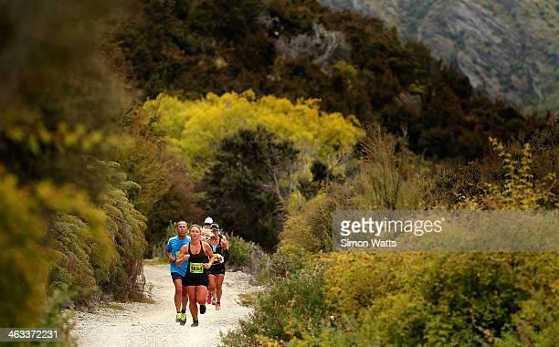 Runners race along the Lake Wanaka during Challenge Wanaka on January 18 2014 in Wanaka New Zealand