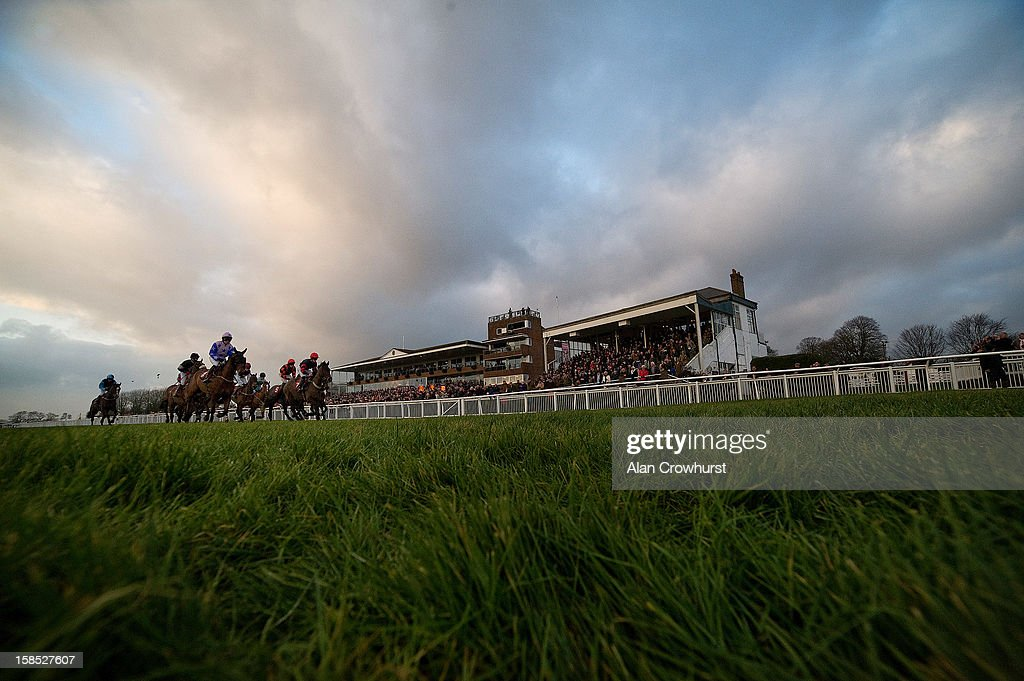 Runners race away from the start of The Skelton Family Christmas Celebration Handicap Hurdle Race during the last meeting to be held after 114 years of racing at Folkestone racecourse on December 18, 2012 in Folkestone, England.