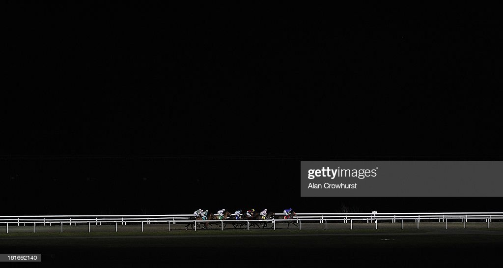 Runners race down the back straight in The Bet Europa League Now With BetVictor Median Auction Maiden Fillies' STakes at Kempton racecourse on February 14, 2013 in Sunbury, England.