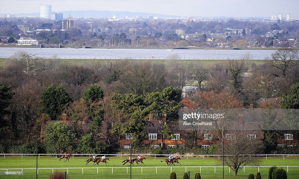 Runners race down the back straight in The Betfred Masters Handicap Steeple Chase at Sandown racecourse on February 02, 2013 in Esher, England.