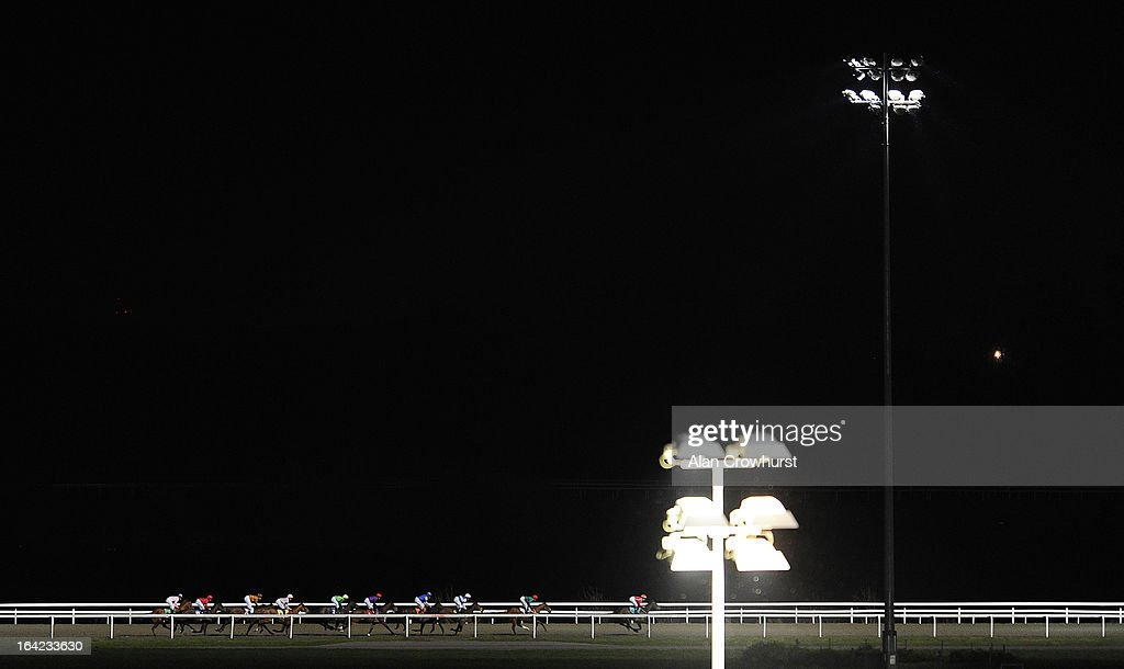 Runners race down the back straight in The BetVictor Non Runner No Bet At Aintree Handicap Stakes at Kempton racecourse on March 21, 2013 in Sunbury, England.