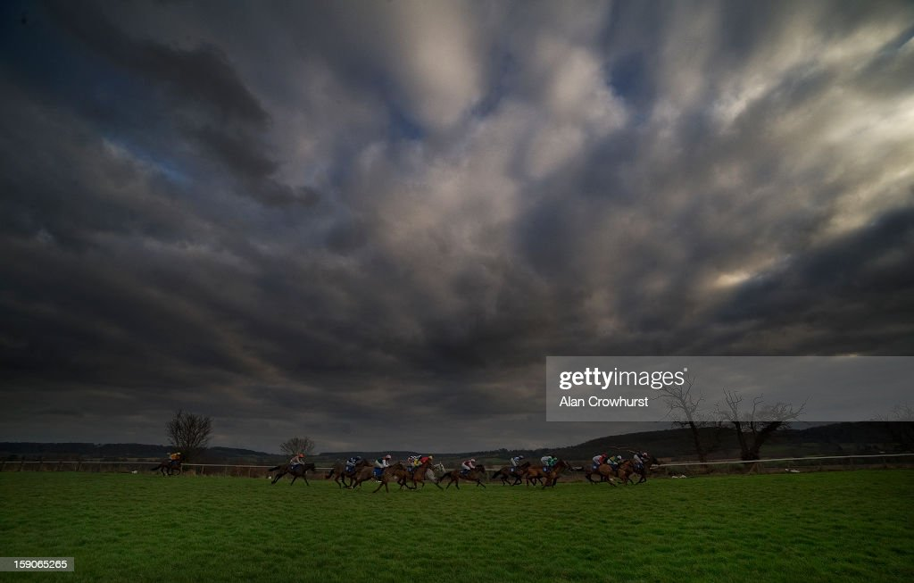 Runners race down the back straight in The Castle Hotel In Taunton 'National Hunt' Novices' Hurdle Race at Taunton racecourse on January 07, 2013 in Taunton, England.