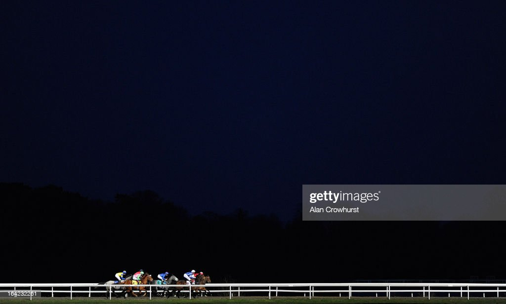 Runners race down the back straight in The Get The BetVictor App Now Median Auction Maiden Fillies' Stakes at Kempton racecourse on March 21, 2013 in Sunbury, England.