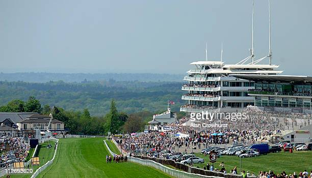 Runners race towards the finish in the Investec Asset Management Handicap Stakes over 5 furlongs during Epsom Races at Epsom racecourse on April 20...