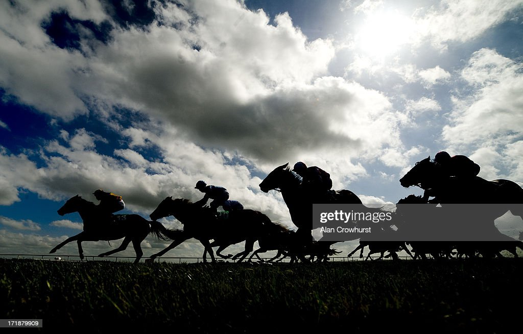 Runners race towards the finish in The Paddy Power Sprint at Curragh racecourse on June 29, 2013 in Kildare, Ireland.