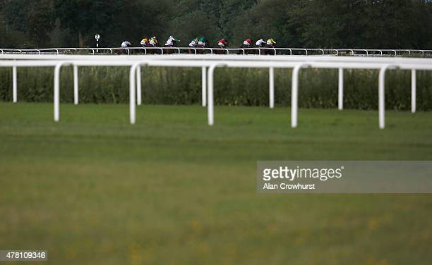 Runners race towards the finish in The Reuben Foundation Maiden Stakes at Windsor racecourse on June 22 2015 in Windsor England